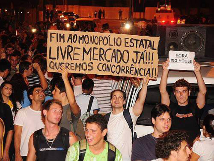 """From recent protests in Brazil: """"End the monopoly of the state. Free markets now! We want competition."""""""