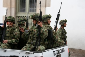 "President Santos has lifted the bombing truce on FARC encampments. (<a href=""http://commons.wikimedia.org/wiki/File:Military_Police_of_Colombia.jpg"" target=""_blank"">Wikimedia</a>)"