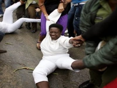 **  CORRECTS SPELLING OF MONTH MARCH  ** Members of the Ladies in White, a group of female dissidents, are removed from the street by security agents during a protest in Havana, Wednesday, March 17, 2010. Uniformed Cuban security agents prevented Ladies in White from marching on the outskirts of the capital to demand release of their jailed husbands and sons, physically removing them when they lay down in the street in protest. (AP Photo/Javier Galeano)