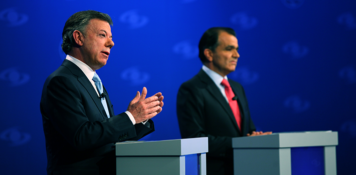 Juan Manuel Santos and Óscar Iván Zuluaga during a debate on Caracol TV