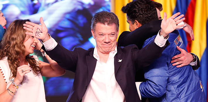 Juan Manuel Santos shows his pleasure and his campaign plank for peace as he accepts victory in Colombia