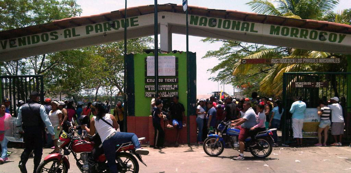 Protestors gather on Friday at the gate to Morrocoy National Park in Falcón, Venezuela.