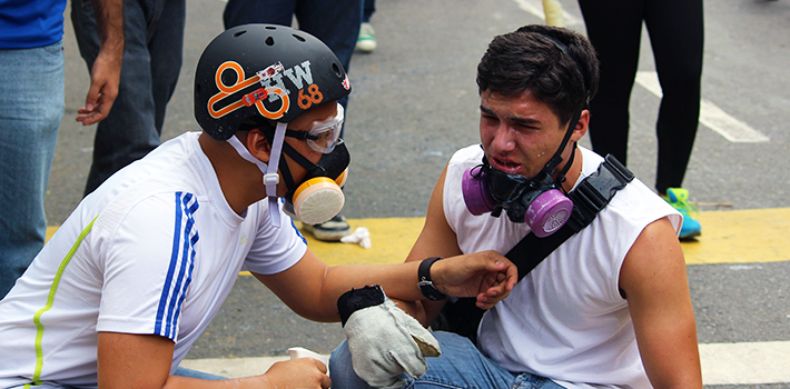 University student reacts to tear gas fired by National Guard during protest