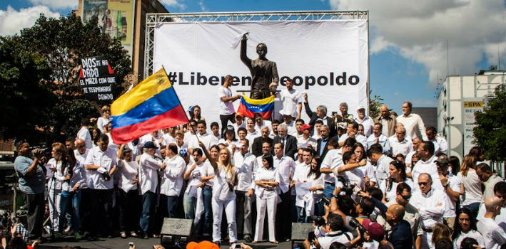 In the square where Leopoldo López surrendered to authorities a year ago, the Venezuelan opposition protesters demanded justice for the political leader.