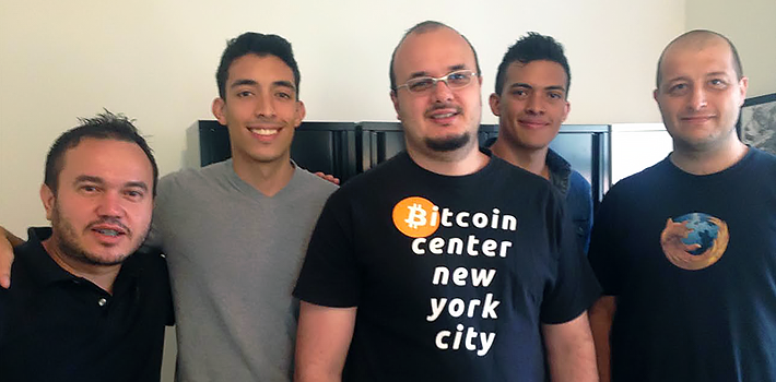 New York City: Rodrgio Souza of BlinkTrade is in the center, flanked by the Charles brothers of SurBitcoin, and then members of his staff.
