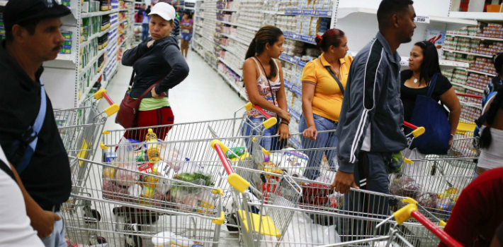 """Venezuelans are stripped of their individuality as the """"masses"""" form endless lines at the supermarket."""