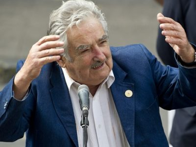 Uruguay's President Jose Mujica speaks to the press after holding a meeting with Chile's President-elect Michelle Bachelet in Santiago, on March 10, 2014. Socialist Michelle Bachelet is to be sworn in on March 11 in Valparaiso, city 120 km west of the Chilean capital.   AFP PHOTO / MARTIN BERNETTI        (Photo credit should read MARTIN BERNETTI/AFP/Getty Images)