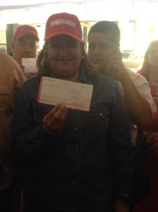"""I fulfilled my revolutionary duty and contributed to the financing of our PSUV,"" wrote Chavista party leader Santaella on Twitter, pictured with her receipt."